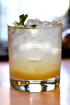Citrus SAVEUR by saveur: A punch-like drink that pairs white corn whiskey with grapefruit juice, mint simple syrup, and homemade sweet and sour. #Cocktails #Citrus