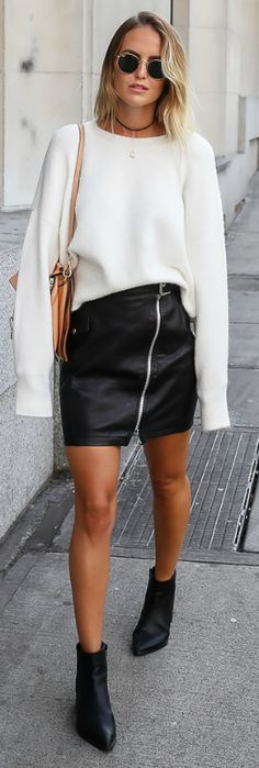A vision in black and cream + Kirsten Sundberg + zip leather skirt + retro sunglasses + oversized knit sweater + Bare legs + high-heeled booties + accentuate the edginess of her street style. Sweater And Skirt Outfits: Sweater: Chiquelle, Skirt: River Island, Boots: Jennie-ellen, Bag: Chloé, Sunglasses: Rayban, Necklace: Na-kd