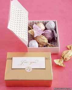For a formal look, wrap chocolates in pleated foil. Line a box with lightweight paper, fill, and wrap in gold foil. The tag is a tented place card; fold it over a ribbon (taped at back), and secure with a seal.