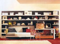Murphy bed built seamlessly into a book shelf