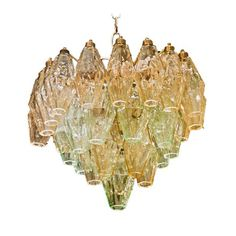 Polyhedral Chandelier by Venini  Italy  c.1950  Four tiered polyhedral chandelier by Venini, c.1950. Alternating rows of pale amber and pale green polyhedral shades give this delicate fixture plenty of style.