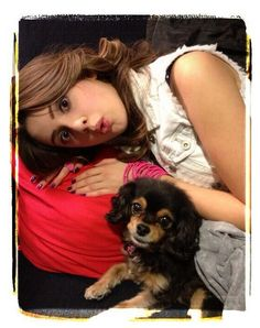 Pixie Cuddling With Laura Marano October 12, 2013