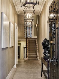The hallway leading to the staircase.