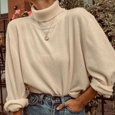 Cool cream turtleneck styling