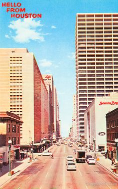 Vintage chrome postcard of Main Street showing the downtown Foley's Department store and Sakowitz in Houston, Texas