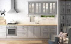 Chic Marble Backsplash And Grey Kitchen Cabinets In Luxury