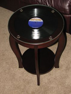 Inspired by a repin to my board, I created my own album table ... a little more upscale! Wooden table, favorite album (Commodores!), glass top.