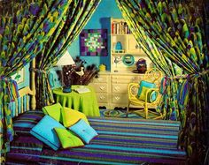 I actually love all of the colors in this room, but whoa pattern overload.  Note the peacock feather rug and the feathers in the corner.