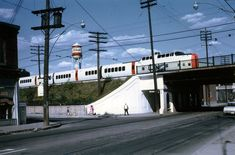 A westbound CN Turbo Train passes over Queen Street on its way to Union Station in 1969.