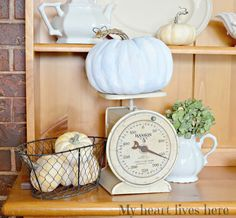 What can you do with those gaudy faux pumpkins? My Heart Lives here shares a beautiful blue painted pumpkin