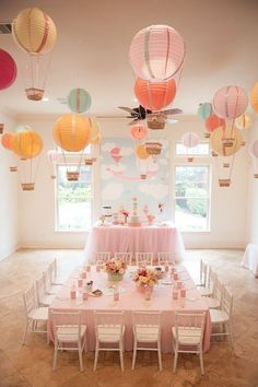 "I love the hot air balloon idea. Create one stunning eye-catching display by hanging paper lantern hot air balloons from the ceiling. This is a great idea for an ""Up In The Air"" baby shower or birthday party! Baby Shower Balloons, Birthday Balloons, 1st Birthday Parties, Themed Parties, 1st Birthday Girl Party Ideas, Baby Birthday Themes, Baby Balloon, Pool Parties, Birthday Design"