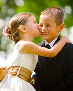 Photo of Flower girl dresses and ring bearer suits
