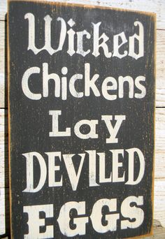 Wicked Chickens Lay Deviled Eggs distressed wood sign. $28.00, via Etsy.
