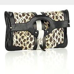 LAMB Cheetah Carlisle Clutch LAMB Cheetah Carlisle clutch. This bag can be used as a clutch or a tote. LAMB Bags Totes