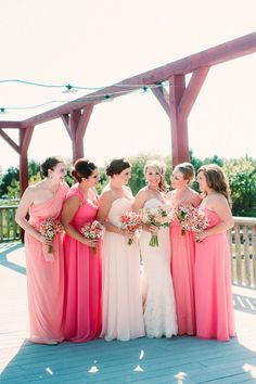 Allowing your bridesmaids to choose their own dress in the hue of your choice (in this case, pink) ensures your group will end up surrounding you with a beautiful ombre of your favorite color on your Big Day.   - HarpersBAZAAR.com