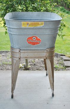 ...got to find something like this for tub to bathe Murphy in!....  Vintage Washtub on Wheels