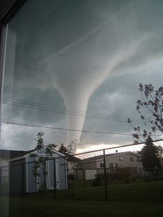 6/22/2007 - Tornado determined to have been an F5.    This wild tornado photo was made by hubby's co-worker, MCpl Gauthier who lives in Elie, Manitoba. He shot this series of pictures from his home window on June 22, 2007. This rare tornado was an F5, and destroyed four homes. Thankfully, no one was hurt.    You can see the same tornado photographed from a different location here.