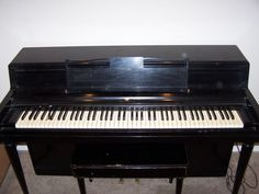 Black Wurlitzer Piano. This looks similar to what I'm getting but a little taller. I can't wait! I love pianos!!