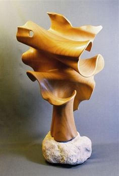 "John McAbery ~ 'Cousteau' ~ Hand carved from California Bay Laurel and mounted on a natural rock base ~  20"" x 11 "" x 7 """