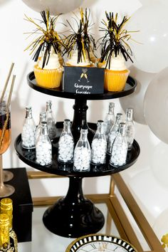 New Years Eve Champagne Cupcakes with Picks and Champagne Favor Bottles - New years eve party ideas and decorations