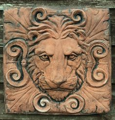 Brighthelm-stone supply high quality stone ornaments for your home & garden. Our range includes decorative roof finials, classical wall plaques, busts, statues, gothic mirrors and green man plaques