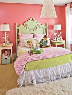 Shades of pink and green make this room an unmistakable haven for a young girl. The soft green bed frame was a family heirloom that got a fresh coast of pastel paint. All new, modern light fixtures and a shag rug bring this fantasy bedroom into the 21st century. (Photo: Laurey W. Glenn)