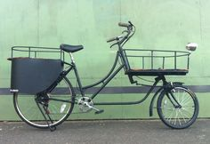 Toms Cargo Bikes. I'd pedal that, especially in a cute color with some woven baskets