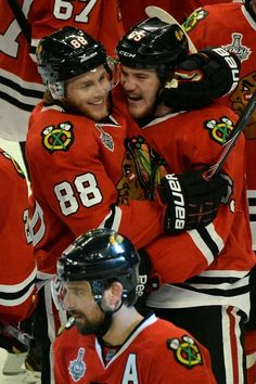 CHICAGO, IL - JUNE 12: Patrick Kane #88 and Andrew Shaw #65 of the Chicago Blackhawks celebrate after Shaw scored the game-winning goal in the third overtime to give them a 4-3 win against the Boston Bruins in Game One of the 2013 NHL Stanley Cup Final at United Center on June 12, 2013 in Chicago, Illinois. (Photo by Harry How/Getty Images)
