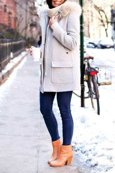 Kat Tanita of With Love From Kat wears a J.Crew coat with J Brand skinny jeans and Rag & Bone newbury booties during the winter in West Village, NYC.