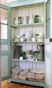 Whitewash and seafoam wardrobe as china cabinet. Doors reminiscent of cottage screen door.