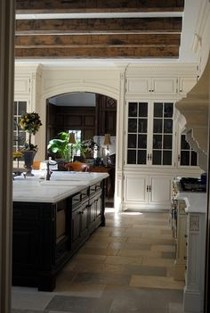 White kitchen, black island....love this color combination!