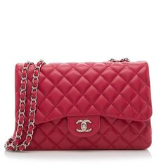 This Chanel Classic Jumbo Flap bag is made from smooth red lambskin with silver-tone hardware. Details include a woven chain shoulder strap, back open pocket, and signature turn-lock closure. The interior is fully lined with four open pockets and one zippered pocket. Carry this style with the straps doubled or extended.