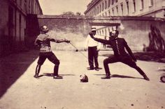 """""""Almost forgotten today, the Grand Salute was a rather elaborate sequence of movements that preceded each bout. A large percentage of 19th-century fencing photos does indeed depict the salute, not any competitive action."""" http://www.youtube.com/watch?v=9BYVwc1qXM4"""