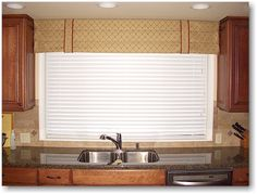 And here is a Roman valance with banding over the kitchen sink.