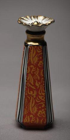 NORITAKE ART DECO SCENT BOTTLE/120./Patterned orange glaze with flower stopper. Red M-in-Wreath, H 13 cm. (5 1/8 in.)
