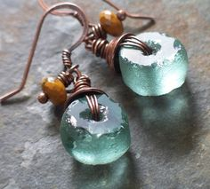 another option for lamp work disc beads Original desc: RESERVED FOR LAURA Recycled Glass Earrings in Sea Green and Goldenrod with Antiqued Copper Glass Earrings, Sea Glass Jewelry, Copper Jewelry, Beaded Earrings, Wire Jewelry, Earrings Handmade, Jewelry Art, Beaded Jewelry, Handmade Jewelry