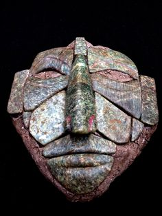 Beautiful works of art such as this jade mosaic mask were created by the Maya not through the use of metal tools, for jade was too hard to be worked by the metals available to the Pre-Columbian Maya. Whatever its previous function may have been, today we are captivated by its spell, and in awe of the artist whose creative efforts produced this dramatic work of Ancient Mayan art.