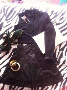 Saturday night outfit: black leather skirt - Influence from TKmaxx, textured crop top with gold zip, monochrome clutch, emerald green stilettos, gold drop earrings with emerald green and purple jewels- River Island, black tuxedo style jacket - H&M, bangles fair trade shop.