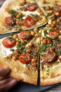 Lebanese style pizza with za'atar, labneh, fresh cherry tomatoes, chickpeas, mint and chili #yum #dinner