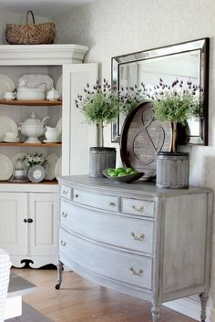 Beautiful Dining Room - a blue painted dresser adorned with lavender topiaries - via Hymns and Verses