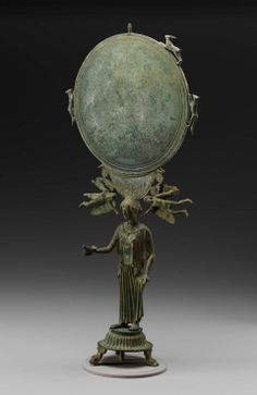 Mirror and stand in the form of a female figure, possibly Aphrodite, 460 BC .