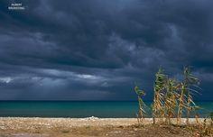 Beach at Lesbos Greece, upcoming thunderclouds.
