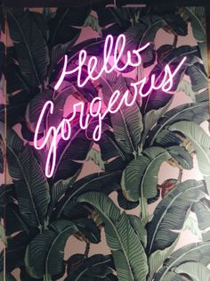 Iconic #wallpaper behind a vibrant #neon sign as wall #decor
