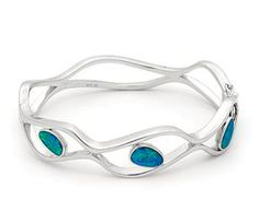 Sterling Silver Light Opal Doublet The flowing lines of the bangle is prefectly complimented by the freeform opals- absolutely stunning 3 stone Free Form 2.47ct approx The flowing lines of the bangle is prefectly complimented by the freeform opals- absolutely stunning #opalsaustralia