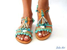 IMPORTANT: Please include a phone number at checkout, as its required by the carrier   FANTASTIC NEWS!!!! WE ARE VERY HAPPY BECAUSE WE OFFER FREE SHIPPING WORLDWIDE 1-4 DAYS with our new cooperation with DHL!!! All my sandals are handmade to order and need 10 days to be made.  These leather sandals are made with pom pom, colorful ethnic ribbon, gold fringe, white elephant beads and of course the turquoise Buddha. Handmade from 100% Genuine Leather Greek Sandals! Be inspired by the beauty of…