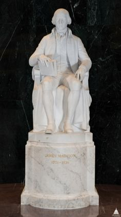 My statue is located in James Madison Memorial Hall of the Library of Congress James Madison Memorial Building. It depicts me in my thirties, sitting erect in a chair that is draped with a cloak; my right foot projects beyond the statue's self base.