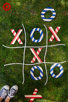 Tic-Tac-T'oh-yeah! Make your own 4th of July-inspired lawn game with Handmade Modern X's and O's and acrylic paints. Use painter's tape to make stripes (the width of a piece of tape will evenly space out the stripes); paint on red, white and blue colors; and let the games begin.