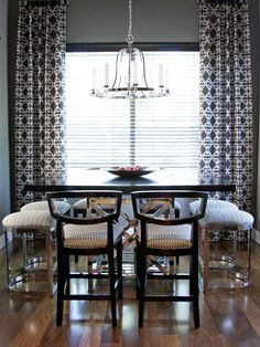 Custom Details  It's important to keep a cool, modern space feeling warm and inviting. Britany designed custom chair upholstery and bold draperies to give this dining room a cozy yet one-of-a-kind look.Share This Photo Gallery  Facebook Twitter Link to this Photo Gallery: