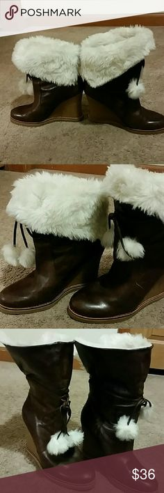 """Leather Booties BY Jessica Simpson DARK brown pair  OF Jessica Simpson  boots  Beautiful  leather  and faux fur booties. Super warm and gorgeous.  Heel 4.5"""" wedges,  they have a few small blemishes,  but are in really good condition a must have for your winter outfits you can work them up high near the knee or you can just roll them down at the knee show your fur while  maybe a pair of distress jean **NO TRADES **NO SNOWBALLING**NO  Modeling Jessica Simpson Shoes Wedges"""