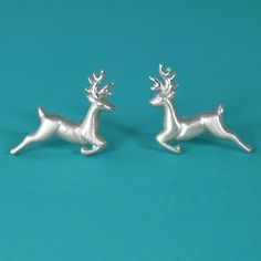Deer Animal Stud Earrings made from 925 Sterling Silver. The perfect Christmas gift for her. You will love their delicate design! These cute earrings have a wonderful detailing and flawless 3D craftsmanship with my unique repousse technique. #deer #christmasgift #deerearrings #christmasjewelry #deerjewelry #deerstud #deerstudearrings #deersilverearrings #deerjewellery